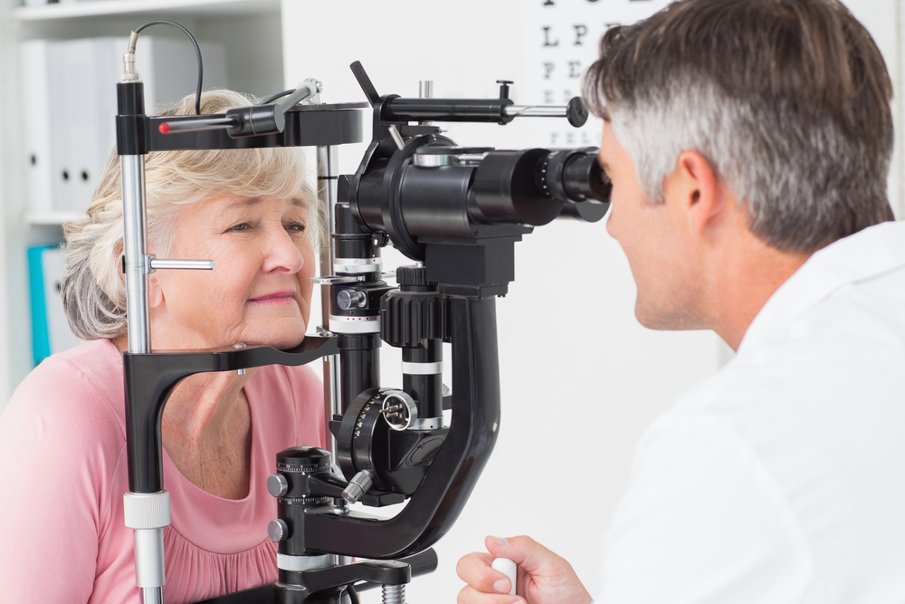 Senior having eyes checked