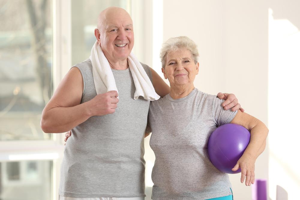 Seniors exercise with a medicine ball